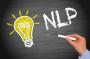 NLP - Neuro-Linguistic Programming chalkboord with light bulb